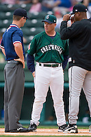 Greenville Drive manager Kevin Boles (19) meets with the umpires prior to taking on the Kannapolis Intimidators at Fluor Field in Greenville, SC, Sunday, April 6, 2008.