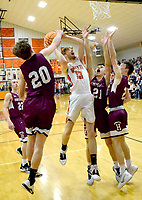 Westside Eagle Observer/MIKE ECKELS<br /> <br /> Lion's senior Brayden Trembly fights his way past three Eagle defenders during the Gravette-Huntsville conference game in the competition gym in Gravette Jan. 24. A last second shoot by an Eagle player cost the Lions the contest 52-51.