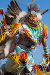 The Men's Fancy Dance dazzles the eye with colorful contemporary regalia, moving and swirling with the beat of the drum. Very competitive events, the Fancy Dance competitions sometimes require three or mor rounds of vigorous dance before the judges can select the winner.