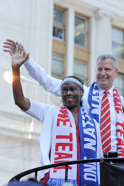 WWW.ACEPIXS.COM<br /> July 10, 2015 New York City <br /> <br /> Chirlane McCray and Mayor Bill de Blasio aboard a float in the New York City Ticker Tape Parade for World Cup Champions U.S.A. Women's Soccer National Team on July 10, 2015 in New York City.<br /> <br /> <br /> Credit: Kristin Callahan/ACE Pictures<br /> <br /> Tel: 646 769 0430<br /> e-mail: info@acepixs.com<br /> web: http://www.acepixs.com