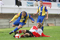 Josh Briant of Beaconsfield challenges Toran Senghore of Romford - Romford vs Beaconsfield SYCOB - FA Cup Preliminary Round Football at Mill Field, Aveley FC - 29/08/10 - MANDATORY CREDIT: Gavin Ellis/TGSPHOTO - SELF-BILLING APPLIES WHERE APPROPRIATE. NO UNPAID USE. TEL: 0845 094 6026