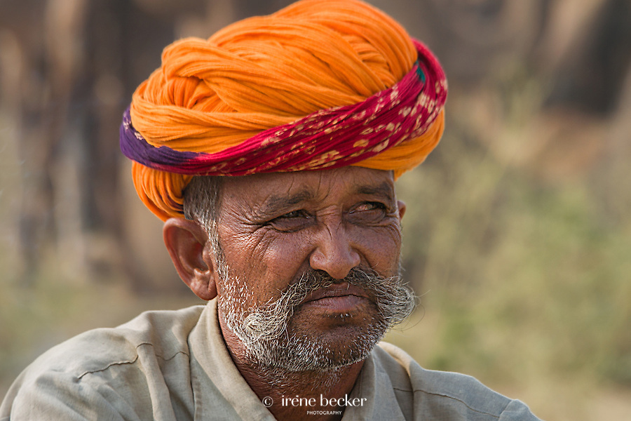Camel  Trader  Portrait. A camel trader waits for customers. Pushkar Camel Fair, Rajasthan, India.
