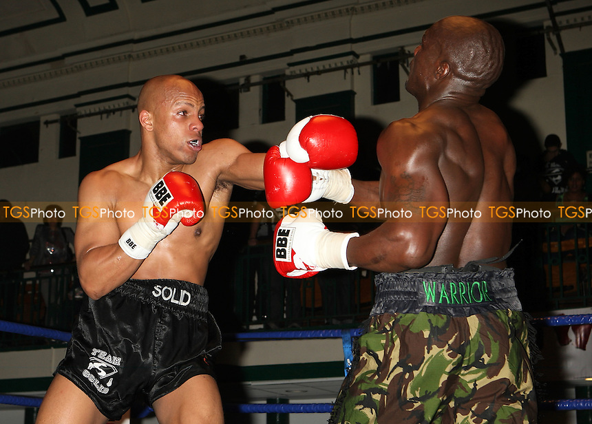 Hastings Rasani (camouflage shorts) defeats Leon Williams in a Cruiserweight boxing contest at York Hall, Bethnal Green, promoted by Left Jab / Miranda Carter - 06/12/09 - MANDATORY CREDIT: Gavin Ellis/TGSPHOTO - Self billing applies where appropriate - Tel: 0845 094 6026