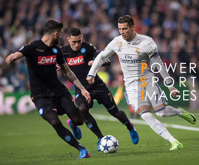 Cristiano Ronaldo of Real Madrid and teammate Marcelo Vieira Da Silva (in white) fight for the ball with Elseid Hysaj of SSC Napoli and teammate Jose Callejon (in black) with during the match Real Madrid vs Napoli, part of the 2016-17 UEFA Champions League Round of 16 at the Santiago Bernabeu Stadium on 15 February 2017 in Madrid, Spain. Photo by Diego Gonzalez Souto / Power Sport Images