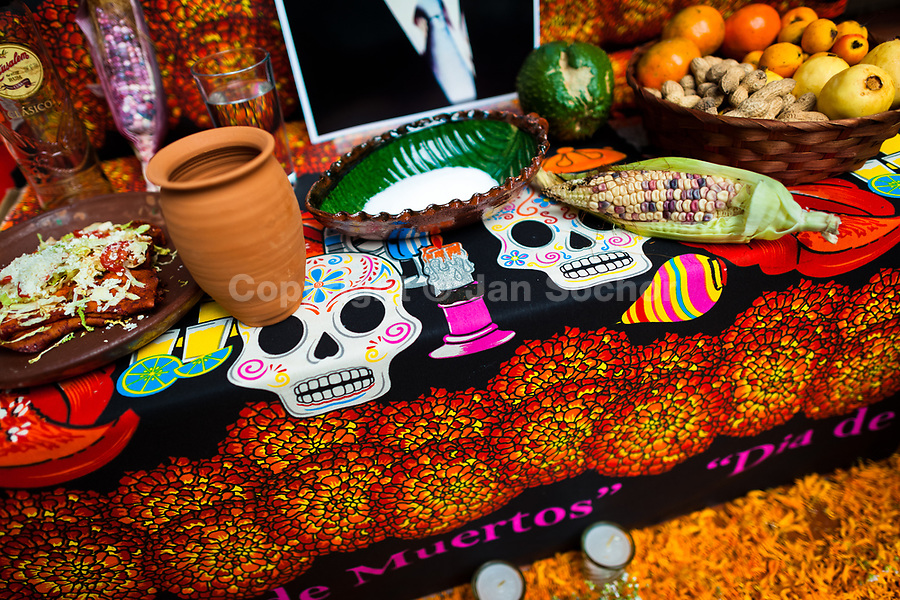 Food offerings are placed at the altar of the dead (altar de muertos), a religious site honoring the deceased, during the Day of the Dead festivities in Morelia, Michoacán, Mexico, 1 November 2014. Day of the Dead ('Día de Muertos') is a syncretic religious holiday, celebrated throughout Mexico, combining the death veneration rituals of the ancient Aztec culture with the Catholic practice. Based on the belief that the souls of the departed may come back to this world on that day, people gather on the gravesites praying, drinking and playing music, to joyfully remember friends or family members who have died and to support their souls on the spiritual journey.