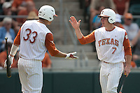 Texas Longhorns shortstop Jordan Etier #7 is greeted by teammate Jonathan Walsh #3 after scoring in the NCAA baseball game against the Texas A&M Aggies on April 28, 2012 at UFCU Disch-Falk Field in Austin, Texas. The Aggies beat the Longhorns 12-4. (Andrew Woolley / Four Seam Images).