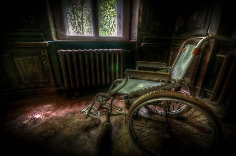 Old wheel chairs in a forgotten care home in East Germany