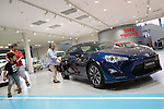 November 5, 2014, Tokyo, Japan - (FILE PHOTO) A file photo shows visitors looking at a Toyota 86 vehicle at the Toyota Motor Corporation showroom in Tokyo, Japan on August 5, 2014. Toyota posted its operating income of 1.3519 trillion yen in which the company revised its forecast to 2.50 trillion yen from 2.30 trillion yen. (Photo by AFLO)