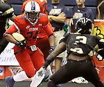 SIOUX FALLS, SD - JUNE 23:  Brandon Walker #24 from the Sioux Falls Storm looks to make a move against Marvin Johnson #3 from the Lee Valley Steelhawks in the first quarter of their first round playoff game Saturday night at the Sioux Falls Arena. (Photo by Dave Eggen/Inertia)