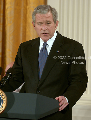 Washington, D.C. - December 15, 2006 -- United States President George W. Bush makes remarks before he and first lady Laura Bush awarded the Presidential Medal of Freedom from  during a ceremony in the East Room of the White House on Friday, December 15, 2006.  The medal is the nation's highest civil award.  It may be awarded &quot;to any person who has made an especially meritorious contribution to (1) the security or national interests of the United States, or, (2) world peace, or (3) cultural or other significant public or private endeavors&quot;<br /> Credit: Ron Sachs / CNP