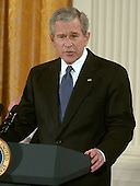 "Washington, D.C. - December 15, 2006 -- United States President George W. Bush makes remarks before he and first lady Laura Bush awarded the Presidential Medal of Freedom from  during a ceremony in the East Room of the White House on Friday, December 15, 2006.  The medal is the nation's highest civil award.  It may be awarded ""to any person who has made an especially meritorious contribution to (1) the security or national interests of the United States, or, (2) world peace, or (3) cultural or other significant public or private endeavors""<br /> Credit: Ron Sachs / CNP"