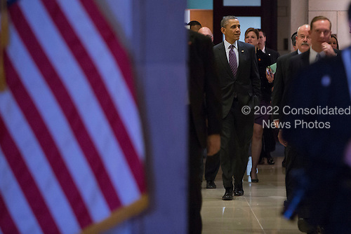 United States President Barack Obama arrives for a meeting with the U.S. House Democratic Caucus on Capitol Hill. Its part of a series of meetings with Republican and Democratic leaders in an effort to reach budget compromise in Washington, D.C. on March 14, 2013. .Credit: Kristoffer Tripplaar / Pool via CNP