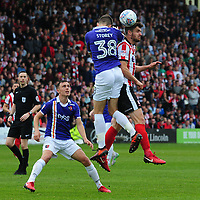 Lincoln City's Luke Waterfall vies for possession with Exeter City's Jordan Storey<br /> <br /> Photographer Andrew Vaughan/CameraSport<br /> <br /> The EFL Sky Bet League Two Play Off First Leg - Lincoln City v Exeter City - Saturday 12th May 2018 - Sincil Bank - Lincoln<br /> <br /> World Copyright &copy; 2018 CameraSport. All rights reserved. 43 Linden Ave. Countesthorpe. Leicester. England. LE8 5PG - Tel: +44 (0) 116 277 4147 - admin@camerasport.com - www.camerasport.com