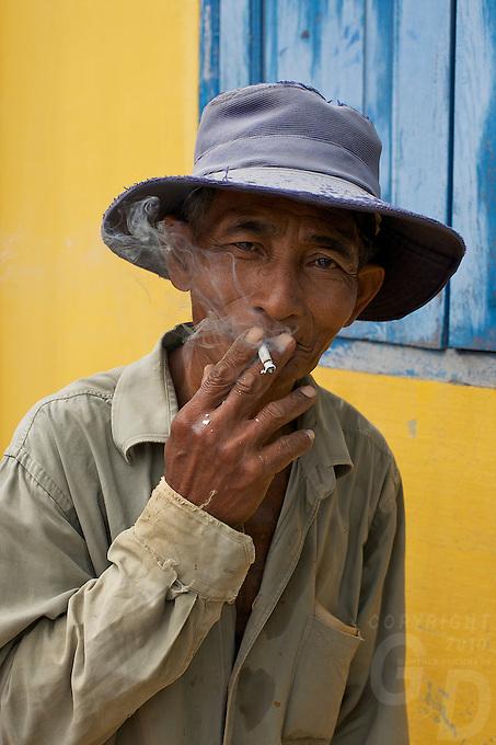 Worker smoking at a Monastery Battambang, Cambodia