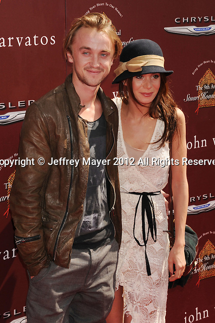 LOS ANGELES, CA - MARCH 11: Tom Felton  arrives at The 9th Annual John Varvatos Stuart House Benefit at John Varvatos Los Angeles on March 11, 2012 in Los Angeles, California.