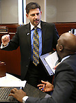 Nevada Senate Democrats Mark Manendo, left, and Kelvin Atkinson talk on the Senate floor at the Legislative Building in Carson City, Nev., on Tuesday, March 12, 2013. Manendo sponsored a measure that would ban two harmful events at some rodeos. (AP Photo/Cathleen Allison)