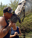 WEST HILLS,NY-MONDAY, SEPTEMBER 3, 2007: Gregg and Susan Lopez of Huntington with &quot;Titania&quot; a Thoroughbred horse with whom Gregg Lopez has bonded in Equine Therapy at the Stanhope Stables in West Hills on Monday September 3, 2007. Lopez suffers from a variety of ailments both physical and mental from the months he worked in recovery efforts at the World Trade Center Ground Zero.<br /> <br /> Newsday / Jim Peppler