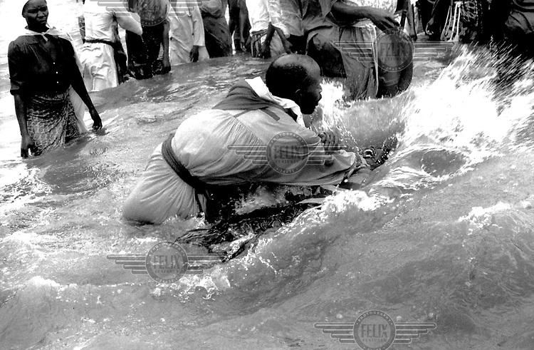 """©Paul Smith/Panos Pictures..Maputo, Mozambique. Baptism and exorcism, """"Igreja Ebenezer""""."""