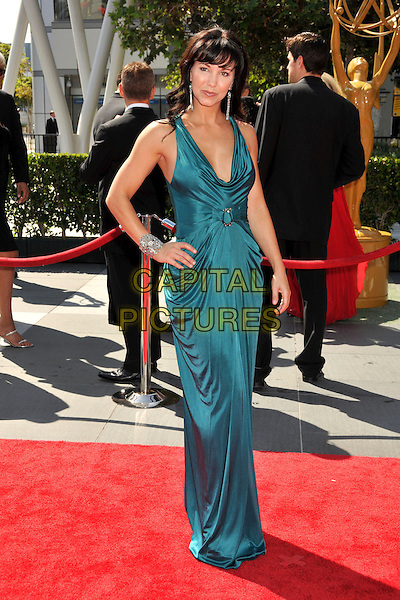 AMIE BARSKY .61st Annual Creative Arts Emmy Awards held at Nokia Theatre LA Live, Los Angeles, California, USA, .12th September 2009..emmys full length green dress long maxi hand on hip silk satin buckle draped .CAP/ADM/BP.©Byron Purvis/Admedia/Capital Pictures
