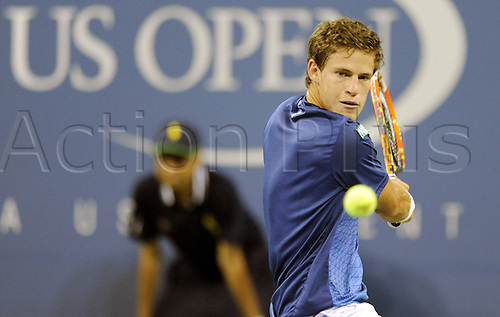 25.08.2014. Flushing Meadows, NY, USA.  Diego Schwartzman of Argentina returns a shot during the men s singles 1st round match against Novak Djokovic of Serbia at the U.S. Open tennis tournament in New York, the United States, on Aug. 25, 2014. Djokovic won 3-0.