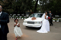 ADDIS ABABA, ETHIOPIA - NOVEMBER 13: A bride and a groom poses for a wedding photographer in a park at Ghion Hotel on November 13, 2010 in Addis Ababa, Ethiopia. The weekends are full of Western style weddings, most popular are to have a Lincoln Town car limos and Mercedes Limos. Some people can afford to put these weddings through in this one of Africa's poorest countries. (Photo by Per-Anders Pettersson)