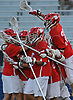 Syosset teammates celebrate after their 9-4 win over Farmingdale in the Nassau County varsity boys lacrosse Class A semifinals at Shuart Stadium, located on the campus of Hofstra University in Hempstead, on Friday, May 25, 2018.