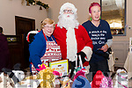 Anne and Heather Moss (Knit and Knatter knitting group)  with Santa at the Dingle Christmas Craft Fair at the Skellig Hotel on Sunday.