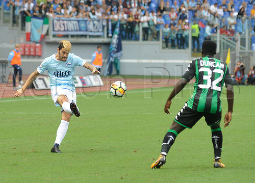 1st October 2017, Stadio Olimpico, Rome, Italy; Serie A football, Lazio versus Sassuolo; Luis Alberto shoots before the cover from Alfred Duncan