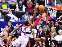 John Wall of the Wizards shoots a layup against Chris Bosh of the Heat. Miami defeated Washington 106-89 at the Verizon Center in Washington, D.C. on Friday, February 10, 2012. Alan P. Santos/DC Sports Box
