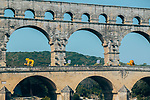 The publicity caravan passes beneath Le Pont du Gard at the start of Stage 17 of the 2019 Tour de France running 200km from Pont du Gard to Gap, France. 24th July 2019.<br /> Picture: ASO/Thomas Maheux | Cyclefile<br /> All photos usage must carry mandatory copyright credit (© Cyclefile | ASO/Thomas Maheux)