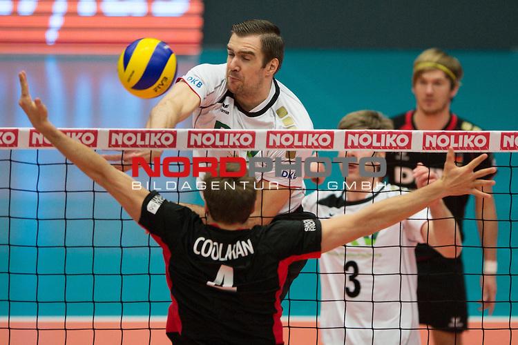 29.12.2013, Lotto Dome, Maaseik<br /> Volleyball, Belgien vs. Deutschland<br /> <br /> Angriff Tim Broshog (#15 GER) - Block Pieter Coolman (#4 BEL)<br /> <br />   Foto &copy; nordphoto / Kurth
