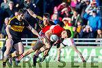 Tomas Mac a'tSithigh Dingle in action against Daithi Casey and John Payne of Dr. Crokes during the Kerry County Senior Club Football Championship Final match between Dr Crokes and Dingle at Austin Stack Park in Tralee, Kerry on Sunday.