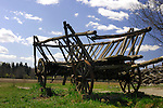 Ancient wooden cart in a field under blue sky. Ukraine, Eastern Europe.