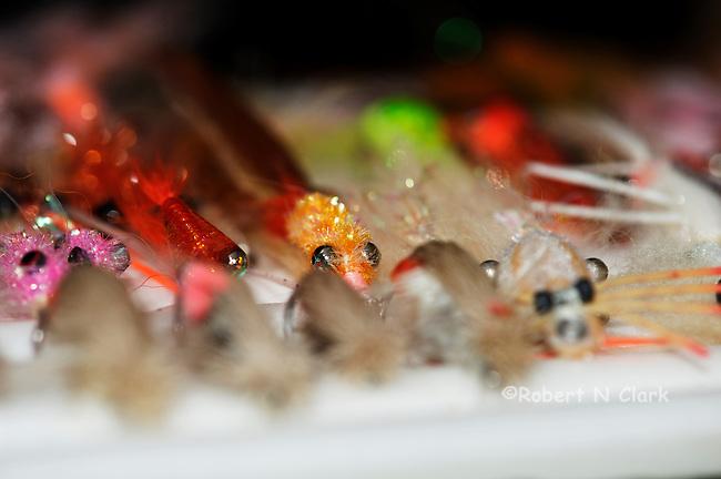 Saltwater fishing flies displayed on a ripple foam board
