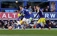 Pictured L-R: Ross Barkley of Everton is chased by Pablo Hernandez of Swansea. Sunday 16 February 2014<br />