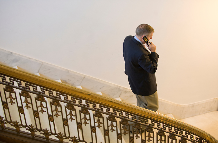 Lindsey Graham, R-SC, talks on his phone as he heads down the steps just off of the Rotunda in the Russell Senate Office Building on April 7, 2010.