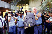 Rio de Janeiro, Brazil. UN security guards manhandling a television cameraman with other cameramen filming; UNCED Earth Summit, 1992.