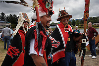 Tlinglet community leaders dressed in full regalia, prepare for a celebration where a canoe will be given to the community.  Six totem poles will be raised in the  town park.  A thousand people attended the historic event,.Tlinglet community leaders dressed in full regalia, prepare for a celebration where a canoe will be given to the community.  Seven totem poles were raised during a historic celebration were 1000 from various native communities came together,
