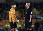 What can you do! Ruben Neves of Wolverhampton Wanderers and Referee Mike Dean during the Premier League match at Molineux, Wolverhampton. Picture date: 14th February 2020. Picture credit should read: Darren Staples/Sportimage