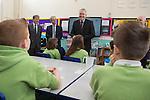 First Minister Carwyn Jones  talks to pupils during a visit to Stebonheath Primary School in Llanelli alongside Bob Ayling &ndash; Chairman Welsh Water, Jonathan Taylor &ndash; Vice President European Investment Bank &amp; Headmaster Mr Julian Littler.<br /> <br /> 08.01.15<br /> &copy;Steve Pope -FOTOWALES