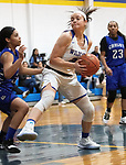 SEYMOUR CT. - 17 January 2020-011720SV11-#21 Morgan Teodosio of Seymour High looks to the basket as #32 Destiny Parros of Crosby High defends during basketball action in Seymour Friday.<br /> Steven Valenti Republican-American