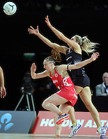 27.08.2016 Silver Ferns Jane Watosn and England's Jade Clarke in action during the Netball Quad Series match between teh Silver Ferns and England at Vector Arena in Auckland. Mandatory Photo Credit ©Michael Bradley.
