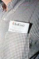 People listen as Texas senator and Republican presidential candidate Ted Cruz speaks to a crowd at a business round-table at the Draft Sports Bar and Grille in Concord, New Hampshire.