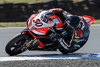 Sylvain Guintoli (FRA) riding the Aprilia RSV4 1000 Factory (50) of the Aprilia Racing Team rounds turn 11 during a practise session on day two of round one of the 2013 FIM World Superbike Championship at Phillip Island, Australia.