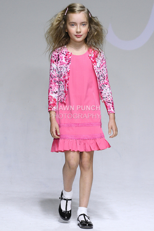 Young model walks runway in an outfit from the IMOGA Collection Spring Summer 2015 fashion show by HeaJung Chung, at petitePARADE Spring Summer 2015, during Kids Fashion Week in New York City, on October 18, 2014.