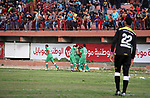 Palestinian Shejaiya's football club players (in green) celebrate after beating Shabab Rafah football club players (in blue) during a football match at Palestine Stadium in Gaza city on March 4, 2018. Photo by Mahmoud Ajour