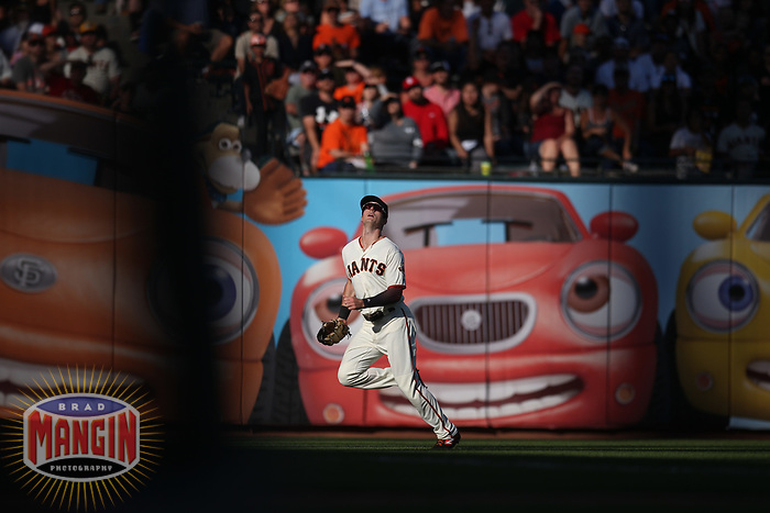 SAN FRANCISCO, CA - AUGUST 11:  Mike Yastrzemski #5 of the San Francisco Giants chases a fly ball in left field against the Philadelphia Phillies during the game at Oracle Park on Sunday, August 11, 2019 in San Francisco, California. (Photo by Brad Mangin)