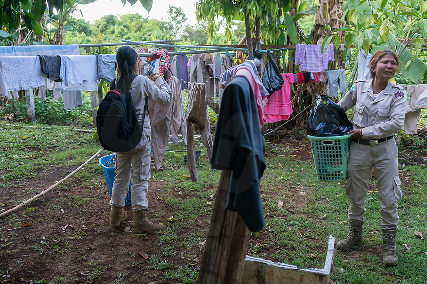 April 26, 2017 - Banlung (Cambodia). Team leader Phorn Chan collects her laundry after a day of work in the field. The majority of the members of the team live and sleep inside NPA's headquarters, a former tourist resort with bungalows and communal areas located in the outskirts of Banlung. © Thomas Cristofoletti / Ruom