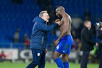Cardiff City manager Neil Warnock celebrates with Sol Bamba of Cardiff City at full time of the Sky Bet Championship match between Cardiff City and Norwich City at the Cardiff City Stadium, Cardiff, Wales on 1 December 2017. Photo by Mark  Hawkins / PRiME Media Images.