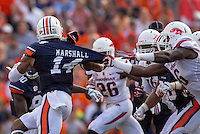 HAWGS ILLUSTRATED JASON IVESTER --08/30/2014--<br /> Arkansas sophomore defensive end JaMichael Winston (right) grabs hold of Auburn senior quarterback Nick Marshall on Saturday, Aug. 30, 2014, against Auburn at Jordan-Hare Stadium in Auburn, Ala.